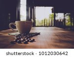 cup of black coffee and coffee... | Shutterstock . vector #1012030642