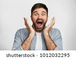 excited male model exclaims in... | Shutterstock . vector #1012032295