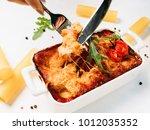 lasagna portion white...   Shutterstock . vector #1012035352