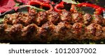 juicy fried kebab meat middle... | Shutterstock . vector #1012037002