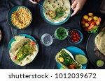female hands cooking vegetarian ... | Shutterstock . vector #1012039672