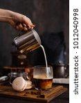 breakfast  hand of woman pours... | Shutterstock . vector #1012040998