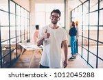 half length portrait of skilled ... | Shutterstock . vector #1012045288