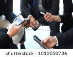 group of people using smart... | Shutterstock . vector #1012050736