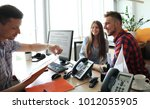 portrait of happy family reach... | Shutterstock . vector #1012055905