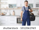 young worker with tool bag... | Shutterstock . vector #1012061965