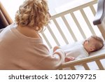 mom with a baby   Shutterstock . vector #1012079725