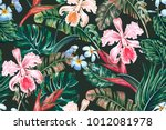 Stock vector tropical floral seamless vector pattern background with exotic flowers palm leaves jungle leaf 1012081978