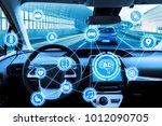 cockpit of autonomous car and... | Shutterstock . vector #1012090705