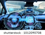 cockpit of autonomous car and... | Shutterstock . vector #1012090708