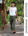 man wearing cargo pants... | Shutterstock . vector #1012137658