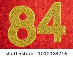 Small photo of Number eighty-four yellow color over a red background. Anniversary. Horizontal
