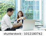 young asian woman or officer... | Shutterstock . vector #1012180762