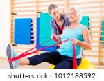 senior woman with stretch band... | Shutterstock . vector #1012188592