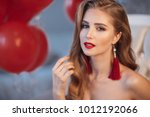 beautiful young woman with... | Shutterstock . vector #1012192066