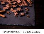 broken chokolate bars and... | Shutterstock . vector #1012196332