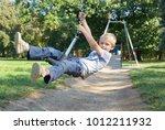 child boy rides on flying fox...   Shutterstock . vector #1012211932