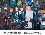 athletic man buying climbing... | Shutterstock . vector #1012229962