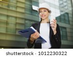 adult woman in suit and hat is... | Shutterstock . vector #1012230322