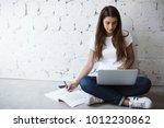 indoor portrait of smart busy... | Shutterstock . vector #1012230862