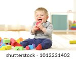 Baby Laughing And Playing With...