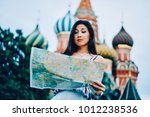asian female tourist pondering... | Shutterstock . vector #1012238536