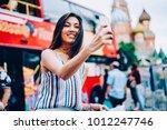 cheerful female traveler making ... | Shutterstock . vector #1012247746