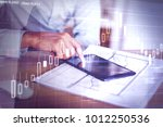 side view of hand using tablet... | Shutterstock . vector #1012250536