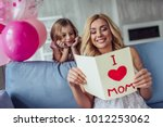 i love my mom  attractive young ... | Shutterstock . vector #1012253062