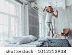 little cute girl is jumping on... | Shutterstock . vector #1012253938