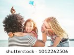 happy family flying with kite... | Shutterstock . vector #1012262506