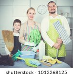 happy family of three dressed... | Shutterstock . vector #1012268125