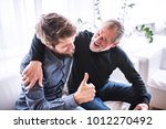 hipster son with his senior... | Shutterstock . vector #1012270492
