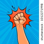 clenched fist drawn in pop art... | Shutterstock .eps vector #1012271998