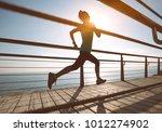 sporty fitness female runner... | Shutterstock . vector #1012274902