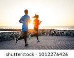 health young couple jogging... | Shutterstock . vector #1012276426