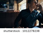 business man with a pen sits... | Shutterstock . vector #1012278238