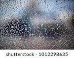 cracks on glass texture broken... | Shutterstock . vector #1012298635