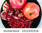 red juice pomegranate on black... | Shutterstock . vector #1012332316