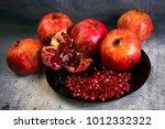 red juice pomegranate on black... | Shutterstock . vector #1012332322