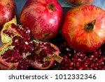 red juice pomegranate on black... | Shutterstock . vector #1012332346