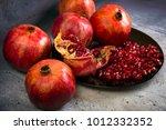 red juice pomegranate on black... | Shutterstock . vector #1012332352
