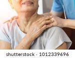 Elderly Female Hand Holding...