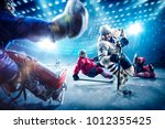 hockey players shoots the puck... | Shutterstock . vector #1012355425