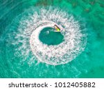people are playing a jet ski in ... | Shutterstock . vector #1012405882