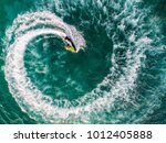 people are playing a jet ski in ... | Shutterstock . vector #1012405888