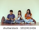 students young asian together... | Shutterstock . vector #1012411426