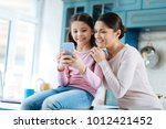 spending time together. pretty... | Shutterstock . vector #1012421452
