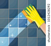 hand in gloves with sponge wash ... | Shutterstock .eps vector #1012428292
