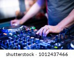 hands. dj music set. console | Shutterstock . vector #1012437466